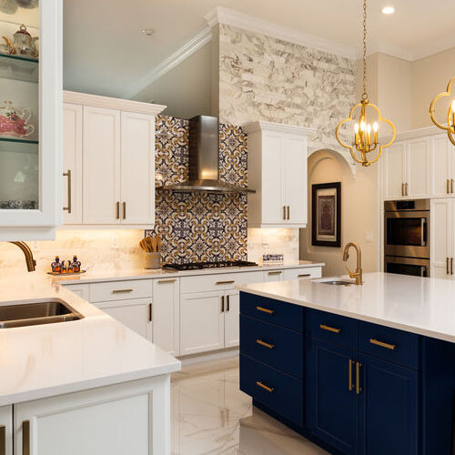 A Kitchen With White Granite Countertops.
