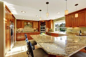 Big Residential Kitchen with Granite Counter tops and Wood Cabinets.