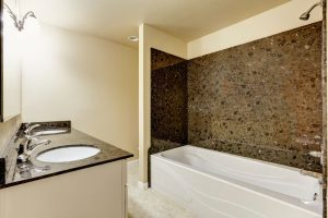A Bath/Shower Combo with Granite Tile Trim